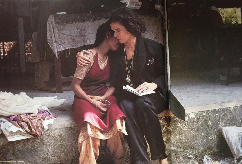 Bianca Jagger comforts a girl rescued from prostitution