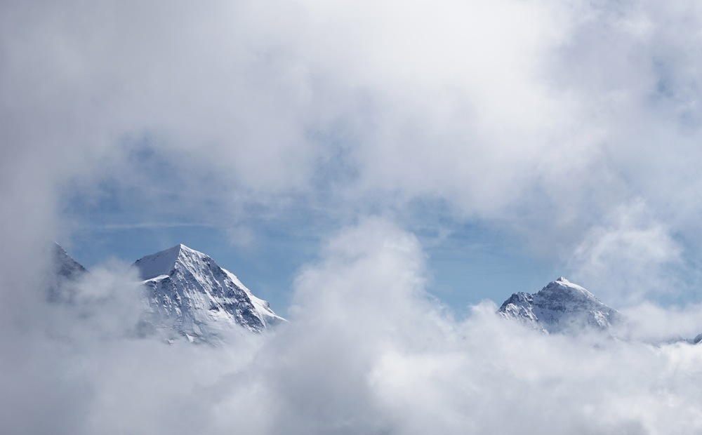FINALLY. Our first sightings of the top of Jungfrau and Eiger as the clouds break up