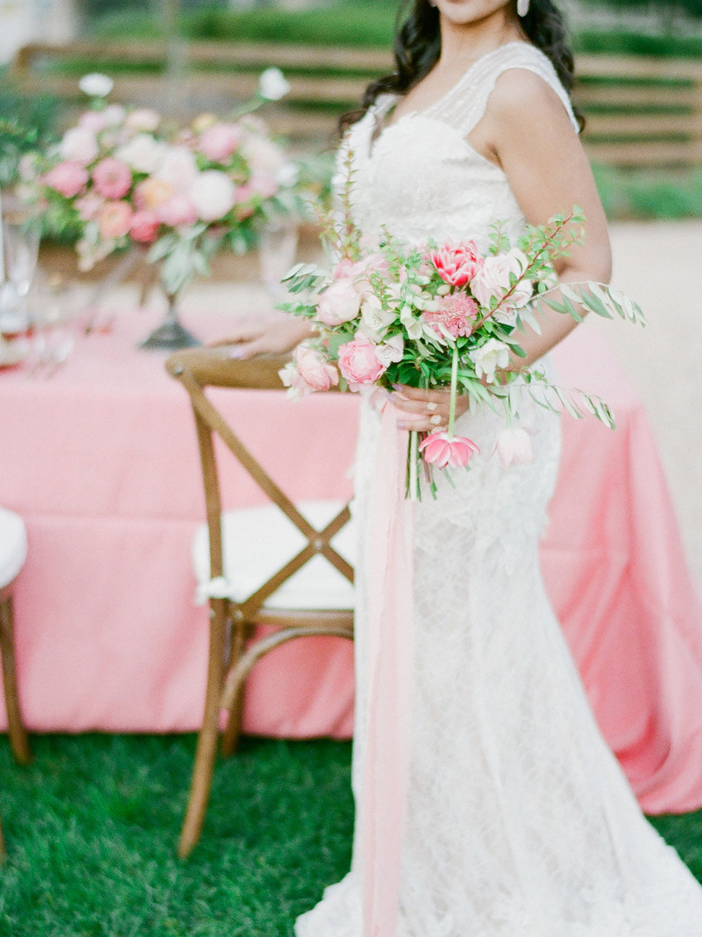 Pretty pink garden wedding bouquet, wedding dress, and table inspo
