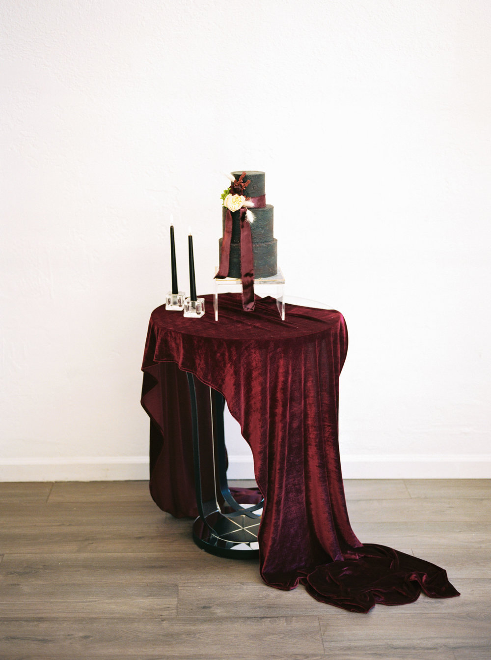gorgeous cake with silk velvet ribbons on dark red silk velvet table linens for wedding and events
