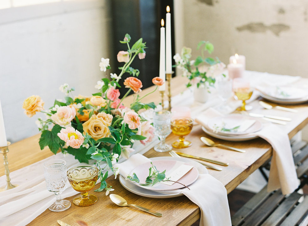 Silk table runners and luscious greens wedding tablescape