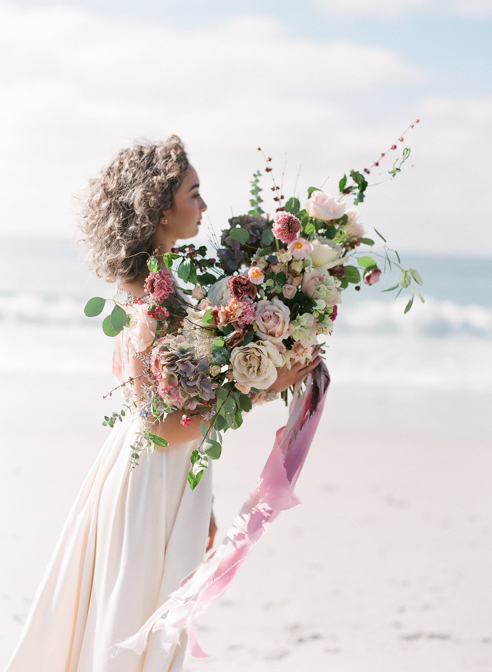 Wedding gown and bridal bouquet goals for beach wedding (Photo: Ashley Noelle Edwards)