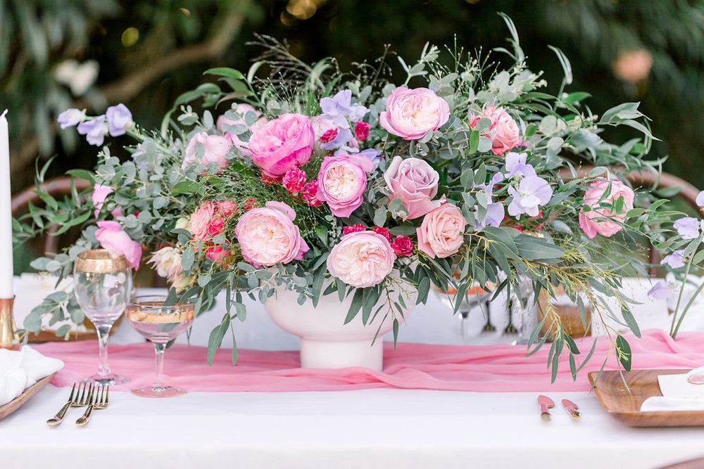 Floral centerpiece arrangement for pink wedding tablescape