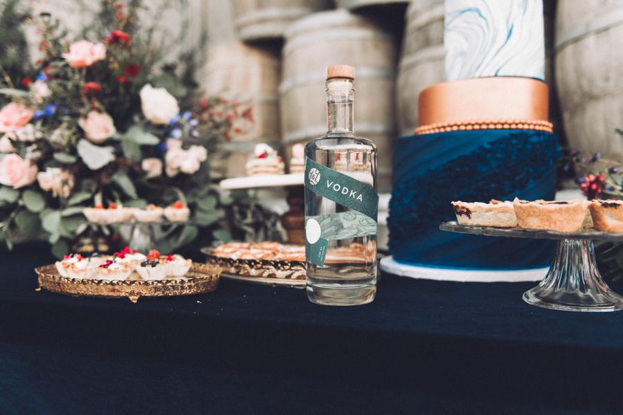 Elegant wedding cake and desserts on gorgeous dark blue velvet table linen