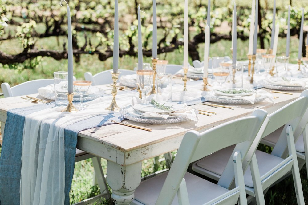 Vintage white and blue wedding tablescape with gorgeous silk and gauze table runners