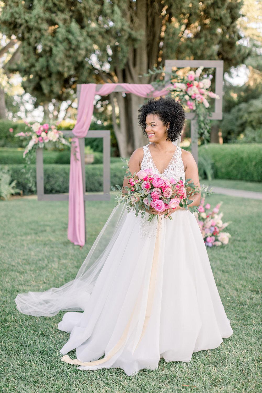 Pink Silk Chiffon Linen, Florals, and Frames Wedding reception installation idea