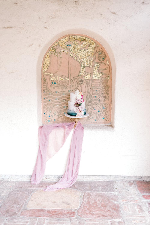 Wall design using wedding cake and silk chiffon table linen