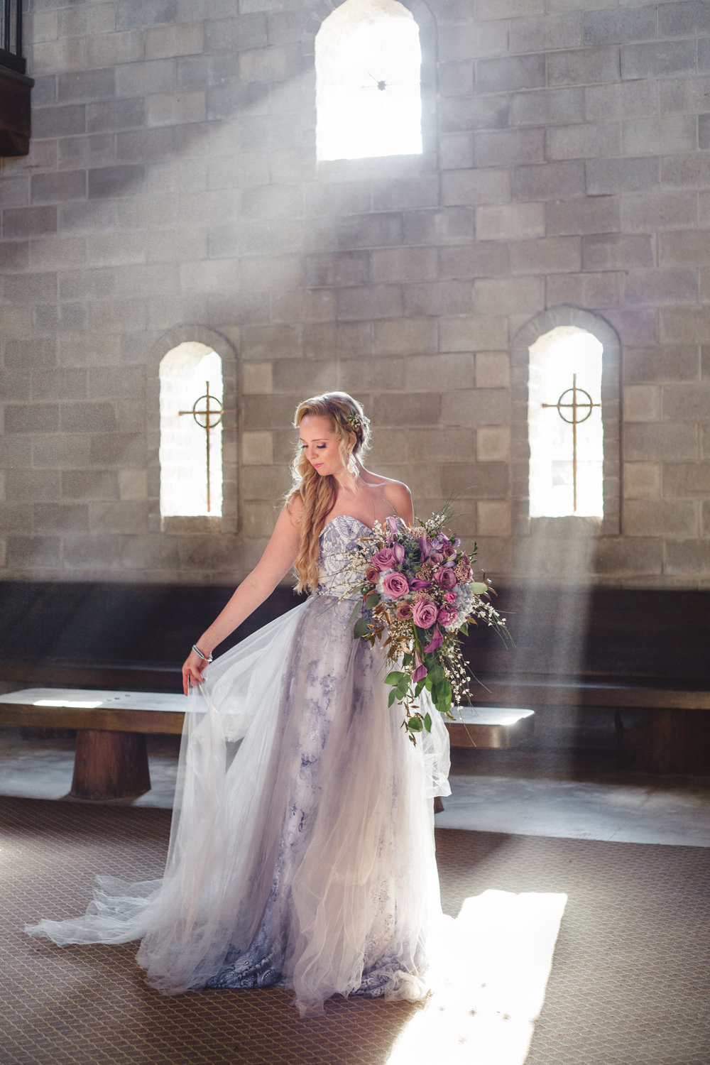 gorgeous bridal gown and bouquet for dreamy castle wedding