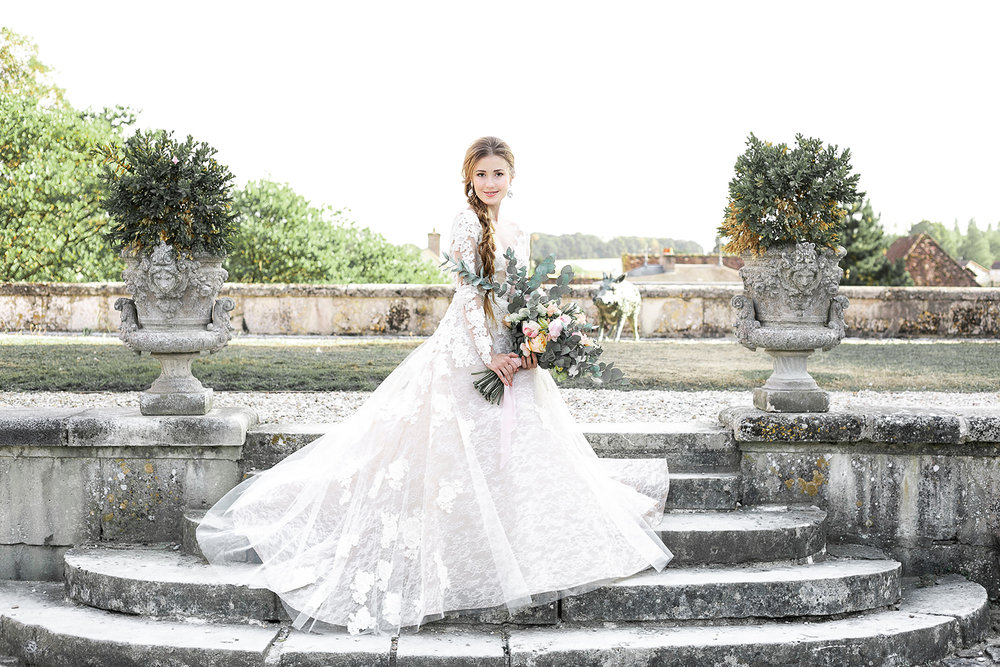 gorgeous wedding gown and bridal hairstyle for castle wedding