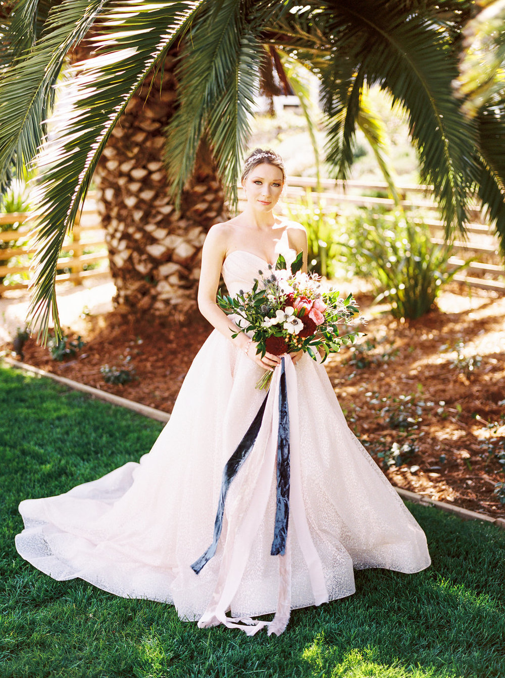 Gorgeous classic princess cut wedding gown with long pink and blue silk velvet ribbon bridal bouquet