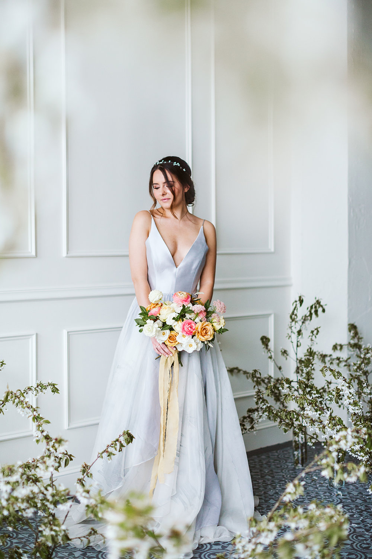 Flowy and soft light blue chiffon wedding gown with pretty light yellow silk ribbon bridal bouquet