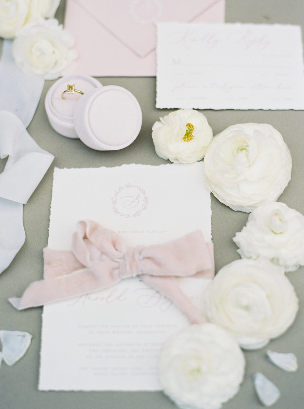 Pretty wedding invitation with calligraphy and pink silk velvet ribbon