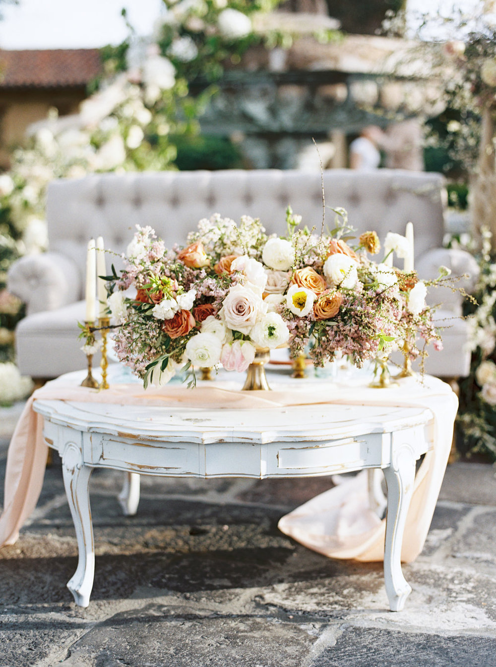 Gorgeous French chateau Outdoor wedding tablescape inspiration using luscious floral arrangements and silk chiffon table runner