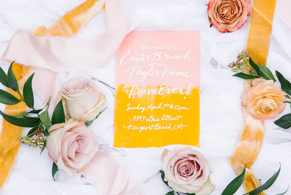 Easter brunch yellow theme inspired calligraphy invitation with silk velvet ribbons and rose flatlay