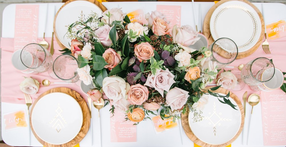 gorgeous easter tablescape with pretty pastel table runners, rose and blooms floral decor, and pretty tableware