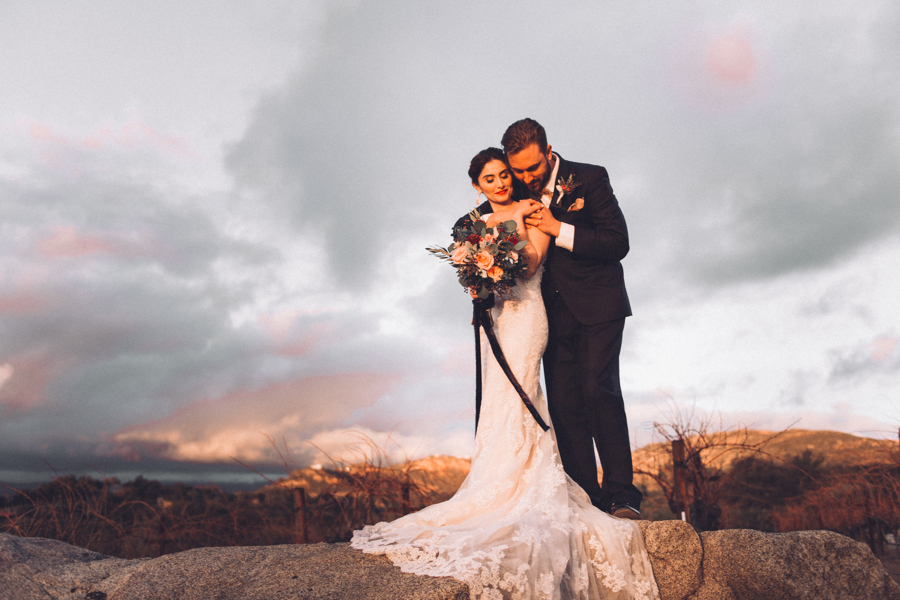 Gorgeous Couple Wedding photo for vineyard theme wedding featuring bridal bouquet with flowy silk velvet ribbons