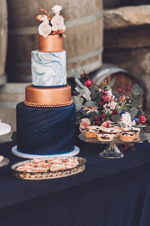 Artistic and Elegant Wedding cake idea on Dark blue silk velvet table linen