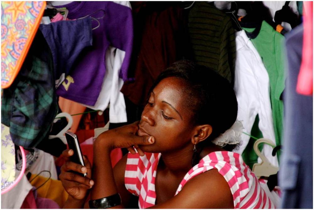 Trader on her mobile phone in an African Market