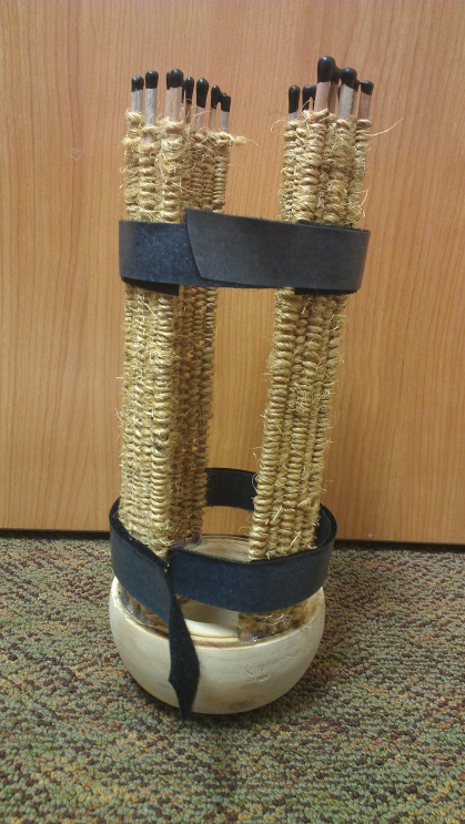 Figure 7. Completed open-frame prosthetic socket with VELCRO® straps.  For the final product, wood dowels and natural sisal were used to weave four wooden stays, which were then glued into the wooden socket cap. This created an open-frame design to allow maximum airflow to the residual limb. VELCRO® straps were attached to the top and bottom of the socket to improve the modularity of the socket.