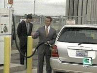 Gov. Schwarzenegger fuels a hydrogen fuel cell Toyota. Image courtesy of KCRA News.