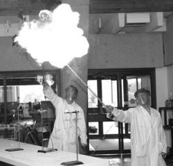 Academic assistants John Eng and Wayne Lippa launch the 2003 Lethbridge Regional Science Festival with a bang during the opening day Chemistry Magic Show at the University of Lethbridge. (Photo Courtesy: University of Lethbridge).