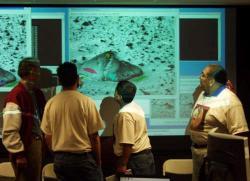 Examining Adirondack. The Laguna-Acoma team examines some thermal infrared data on the Adirondack rock at Gusev Crater. Image courtesy of NASA.