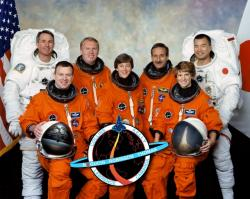 Figure 3. Space Shuttle crew for the Return to Flight mission. In front: Eileen M. Collins (right), commander; Wendy B. Lawrence, mission specialist; and James M. Kelly, pilot. In back are mission specialists: Stephen K. Robinson (left), Andrew S. W. Thomas, Charles J. Camarda, and Soichi Noguchi. Image Courtesy: NASA.