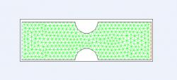 Figure 1. Two-dimensional cross section of control grid with symmetric constriction. Venturi diameter was 5 mm and constriction diameter was 1.5 mm deep and 3 mm wide (moderate). Green lines represent triangular mesh, blue line designates velocity inlet, and red line designates pressure outlet. Model was created in Gambit for subsequent simulation in Fluent.