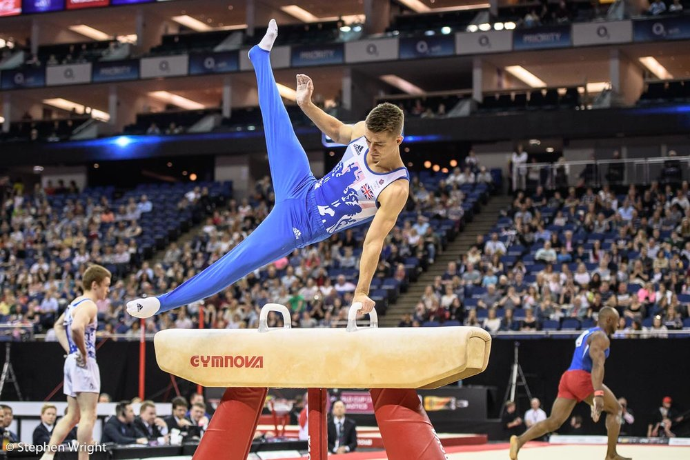 Max Whitlock  giving a demonstration on the Pommel Horse during the  World Cup of Gymnastics  at the  O2 ,  London .