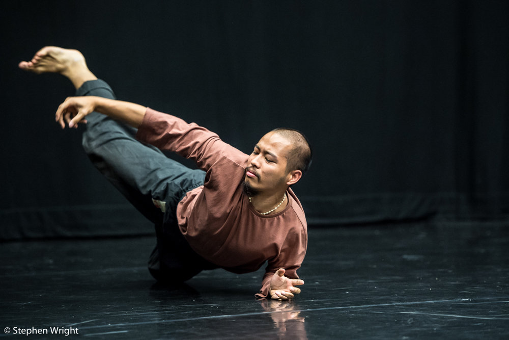 James Gallego Olivo  peforming  Lewis Cooke 's work-in-progress during the  Sadler's Wells Young Associates Summer School .