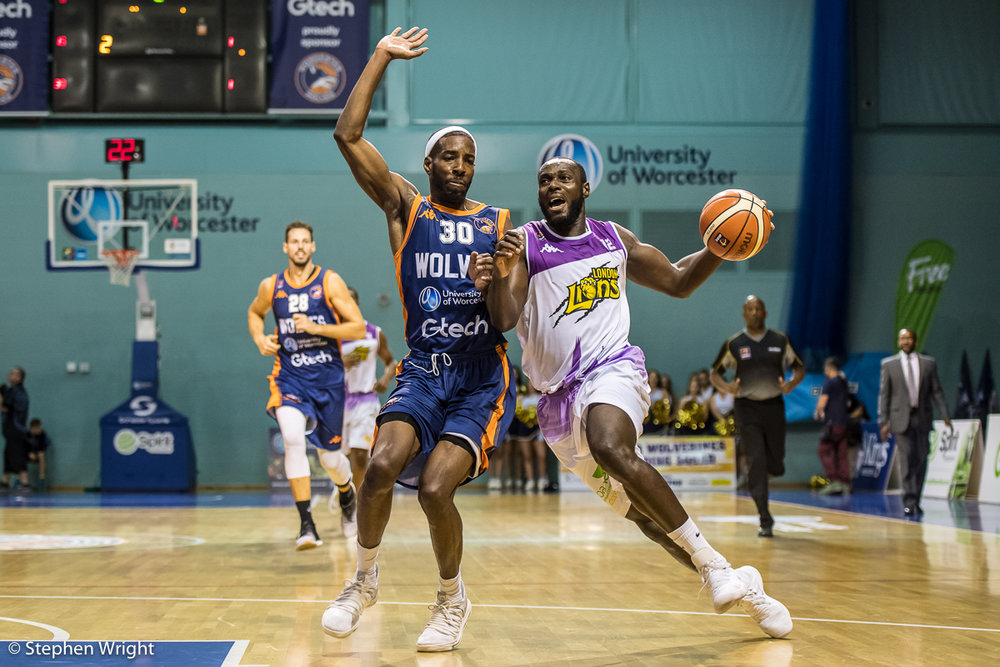 Paul Guede of the London Lions is attempts to get around Jermel Kennedy of the Worcester Wolves.