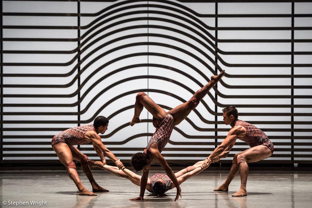 Stephen Quildan ,  Liam Francis ,  Joshua Barwick  and  Adam Park  performing  Rambert 's,  Symbiosis  choreographed by  Andonis Foniadakis .