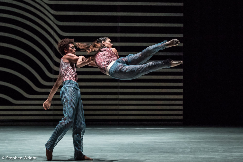 Liam Francis  and  Nancy Nerantzi  performing  Rambert 's,  Symbiosis  choreographed by  Andonis Foniadakis .
