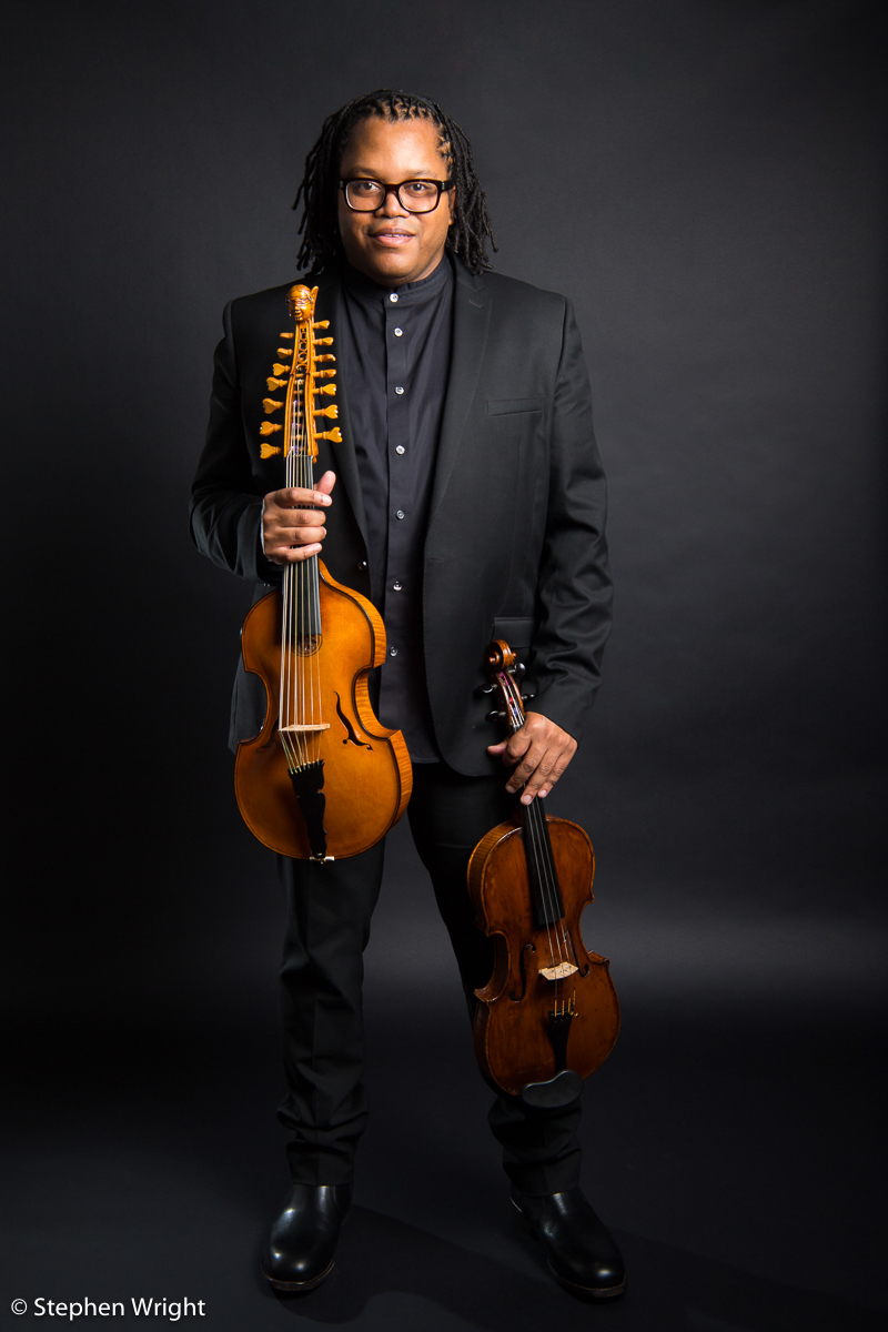 Classical musician,  Clifton Harrison  on-set with both his Viola and the baroque Viola d'Amore.