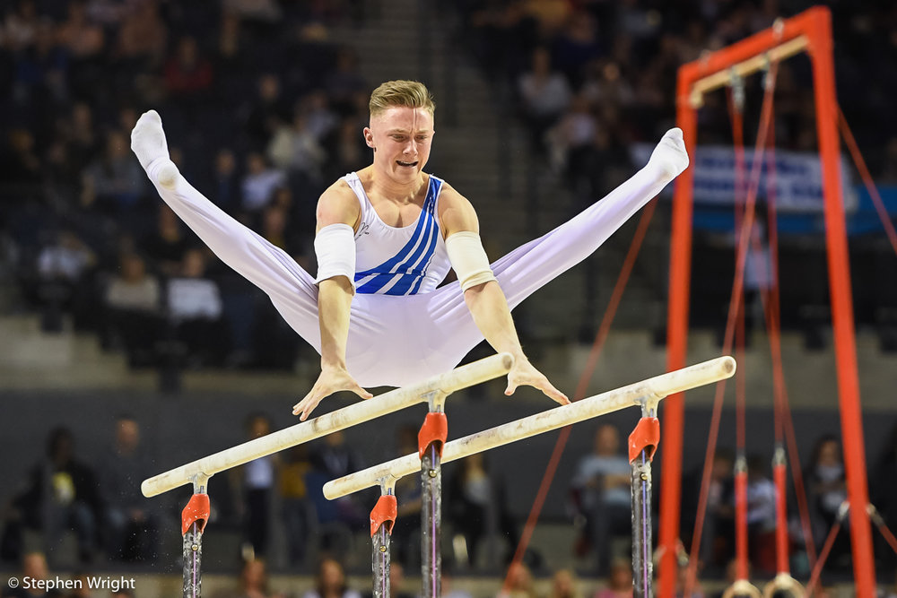 Nile Wilson  on the Parallel Bars.