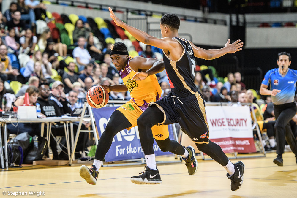 Jerelle Okoro  of  London Lions  takes on  Bouna Ndiaye  of  Glasgow Rocks  in the  British Basketball League  game.
