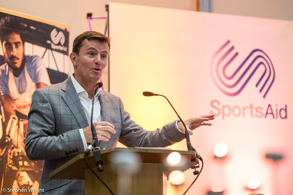 Tim Lawler  gives a speech as part of the  SportsAid Lunch Club  in Milton Keynes.