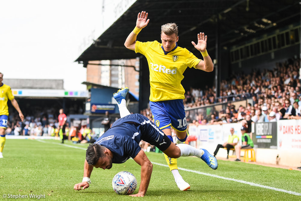 Ezgjan Alioski  of  Leeds United  and  Harry Kyprianou  of  Southend United  battle for the ball.