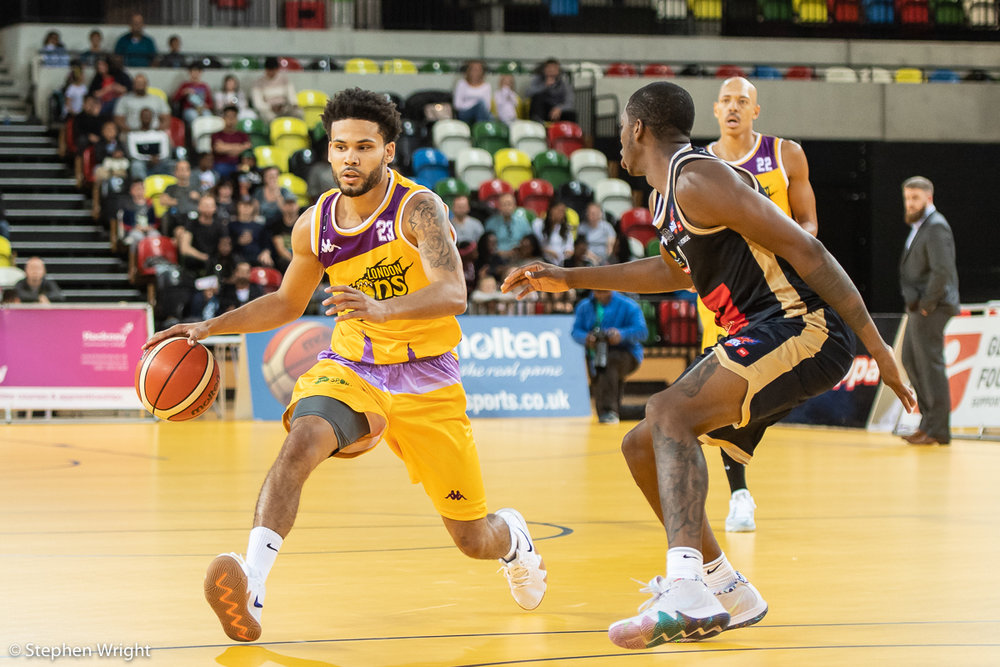 Jordan Spencer  of  British Basketball League  side  London Lions  in action against the  Glasgow Rocks  at the  Copper Box Arena .
