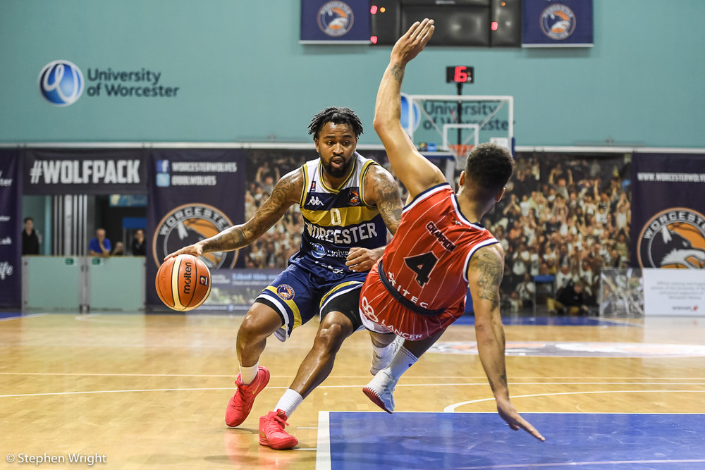 Darell Combs  of  Worcester Wolves  takes on  Lewis Champion  of  Bristol Flyers  during the  British Basketball League  game.