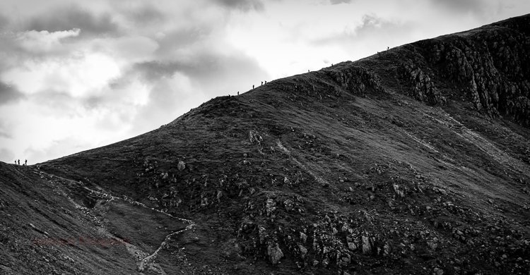 Sheer scale and the looming storm had put me off but seeing so many people at the second peak I could not resist.