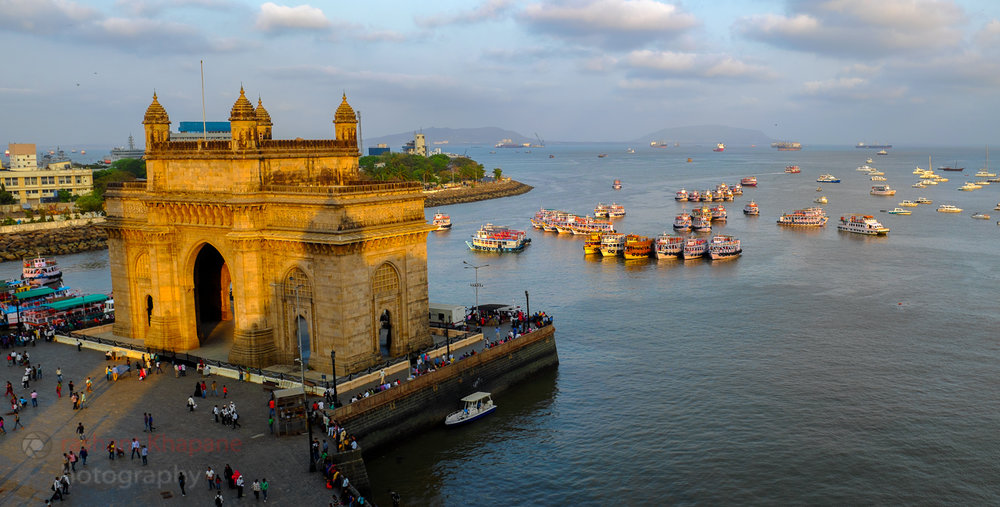 The Gateway of India from the iconic Taj Mahal Palace Hotel. Fuji X100s, Handheld, 2 image panorama.