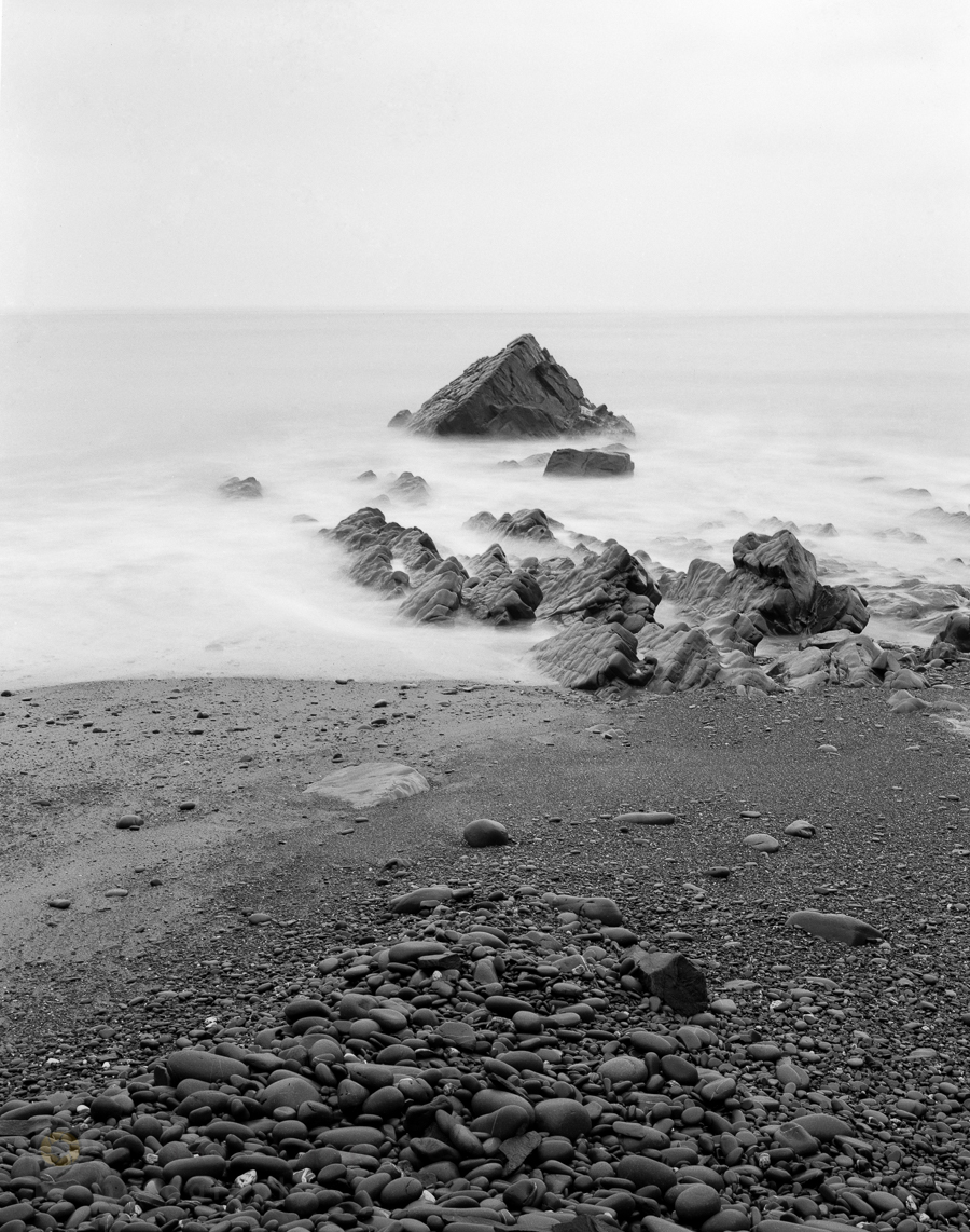Chamonix 45N2 with Rodenstock Sirnoar S 150mm/f5.6. Ilford fp4+ exposed at ISO100. Largest triangular sea stack at Zone 3 and developed for 6min in Ilfosol at 21C. Click to view large.