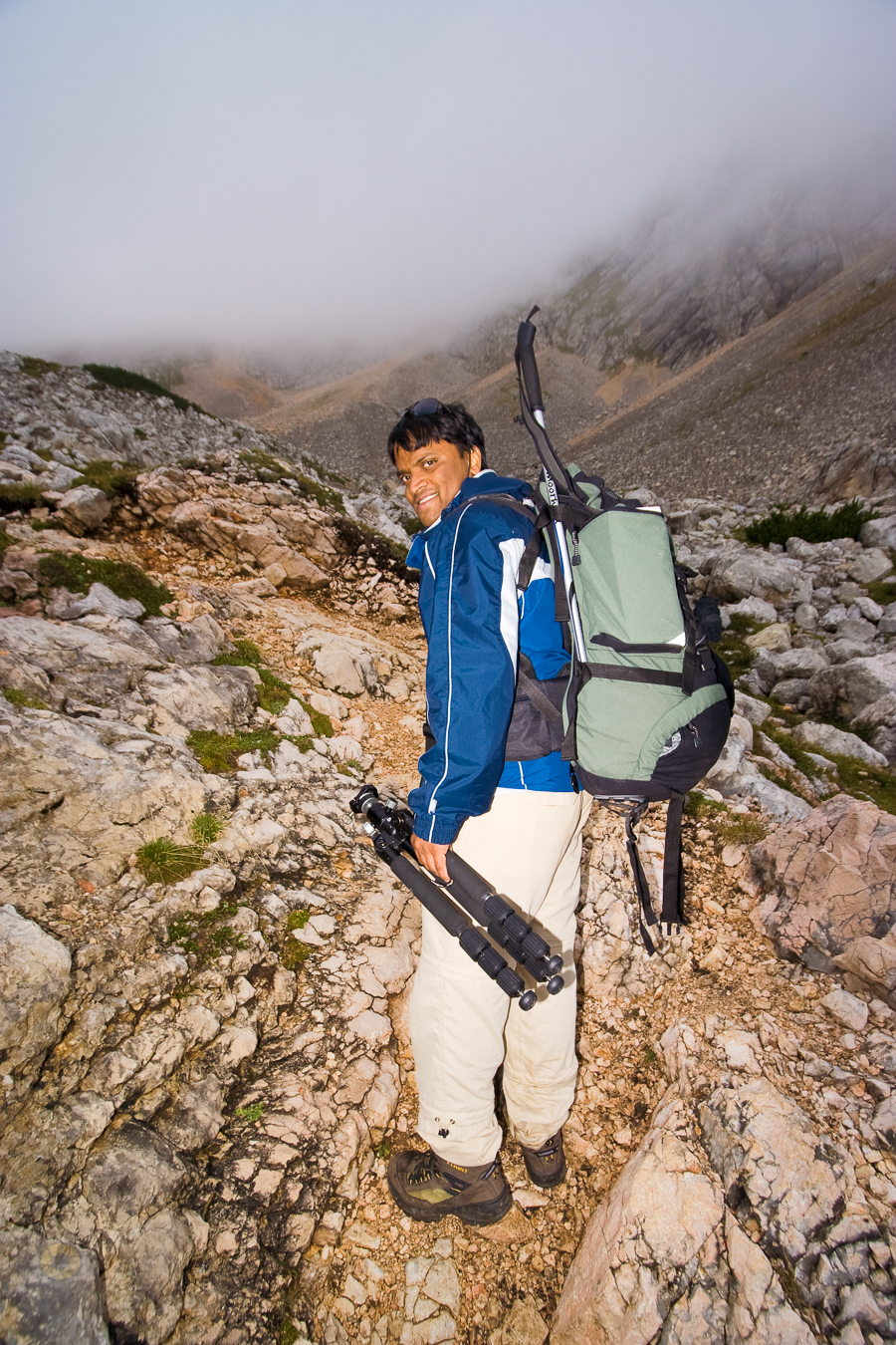 Please note that all the gear I've listed is bought, tried and tested by myself. I will only recommend what I think works in the mountains or back-country. This is just to make life easy in the mountains. This above photo of myself, taken by  Juza  while we did the hut-to-hut hike in the Dolomites, show cases what I used to own in my late 20ies. Except the shoes (Lowa) and the tripod (Slik carbonfibre) everything is bought for a two digit sum in euros. Remember - owning all the gear but not actually being out there is kind of pointless. Just go out and buy the gear as and when you can afford it.