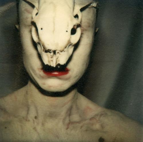 Birgit Jürgenssen . Untitled (Self with skull). 1979