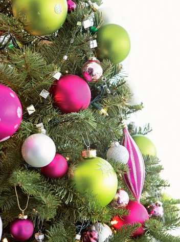 Consider coordinating your holiday decor with your holiday party. Don't you love the bright green and pink ornaments? Such a fun and fresh tree theme. Add some glitter for the perfect party palette.