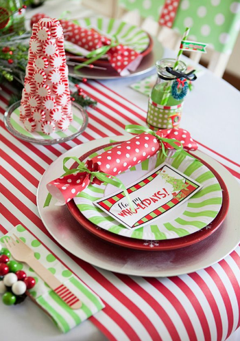 Your guests will love the extra time and attention you put into a beautiful table setting for your dinner party. We love the layered green and red details of this table. Consider using bold patterns and festive candy details to complete a beautiful table.