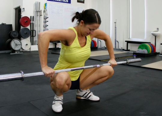 Using a 35-45 pound barbell, come down into a squat with knees and feet slightly turned out. Rest the barbell on your thighs right above the knee. Hang out here for two minutes and feel the magic happen!