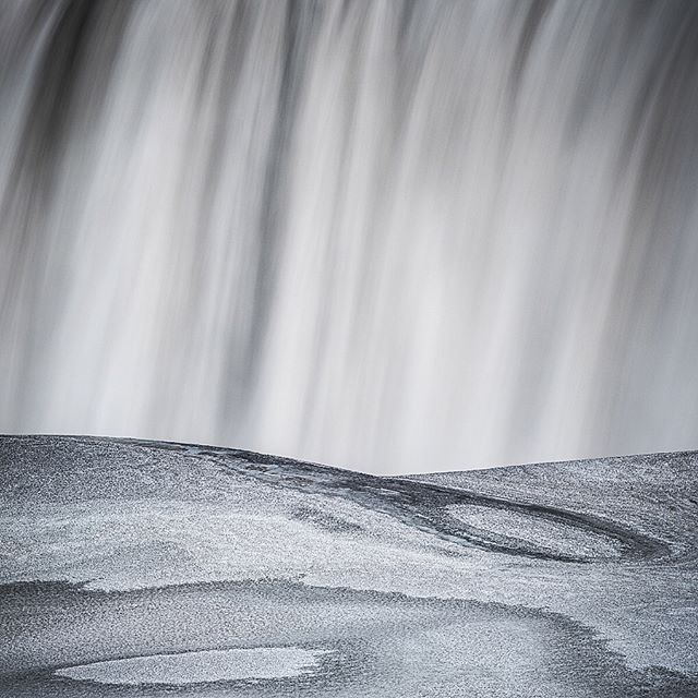 The inevitable down days in #Iceland lead to #exploring some of what this magical country has to offer... naturally waterfalls were high on the list and I got a little #creative with my compositions and exposure lengths at Europe's most powerful #waterfall Dettifoss.  The surrounding snow and #ice build-up made for some #surreal #patterns, revealing different layers of dirt as it slowly melted away. A perfect element to #contrast against the water flowing over the falls for some #abstract #landscape shots!  @NikonNZ @LeeFilters @LongExposure_Shots 📷 1️⃣ #Nikon #D810 70-200mm f/2.8 VRII at 105mm, f/16, 1s, ISO 250