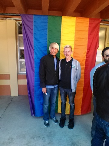 Isaiah Wallowingbull (left) and his partner Troy Nichols in front of Jazzie's Place in San Francisco.